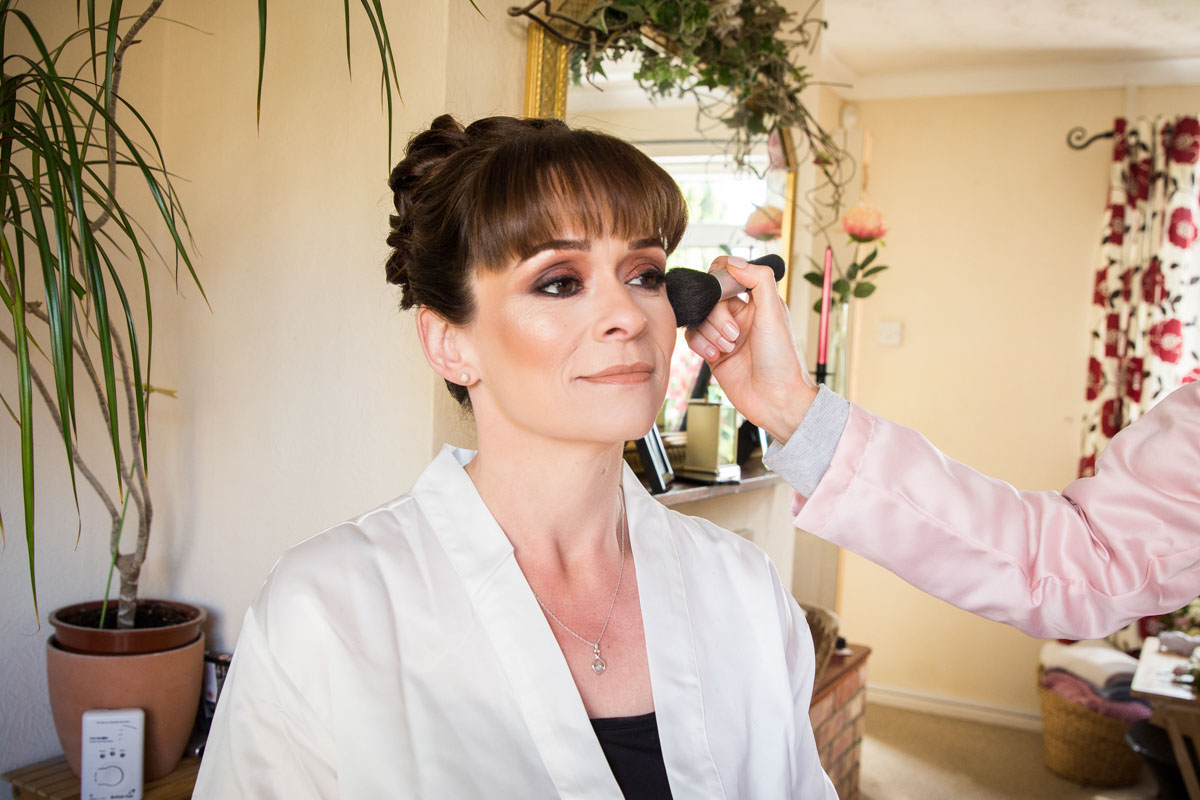 Bridal makeup being applied, Scotland wedding photographer.