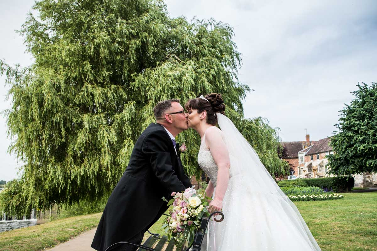 Wedding photographer Glasgow. Cotswolds wedding. Bride and groom kissing