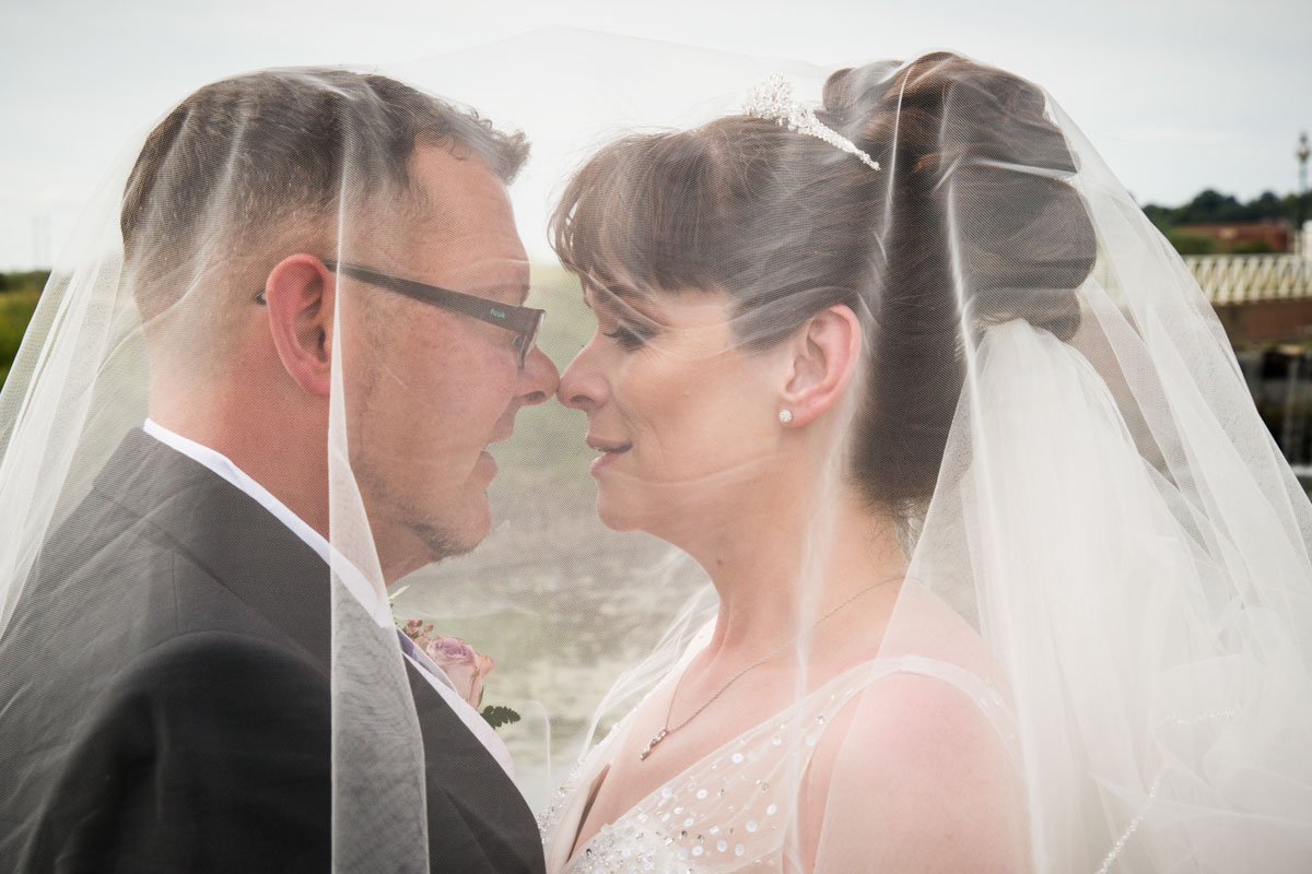 Bride and groom veil photography. Wedding photographer Glasgow
