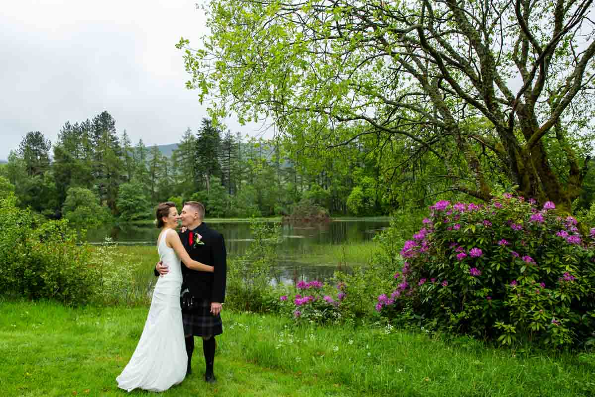 Culcreuch Castle lake during bride and groom portraits
