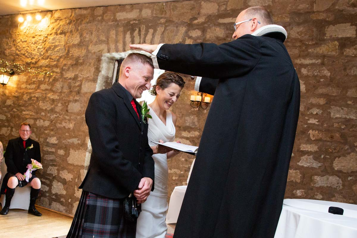 Bride and groom during service at Culcreuch Castle wedding venue.
