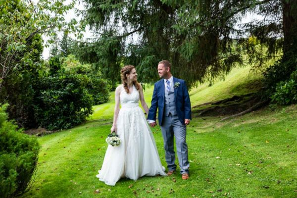 Bride and groom in the grounds at MacDonald Forest Hills Hotel